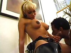 Tranny in latex fucks chocolate guy