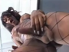 Black TS in fishnet fucking w bloke