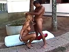 Blond ts blows black guy outside